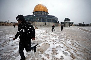 Holy Sites Under Layer of White after Rare Snowfall in Al-Quds